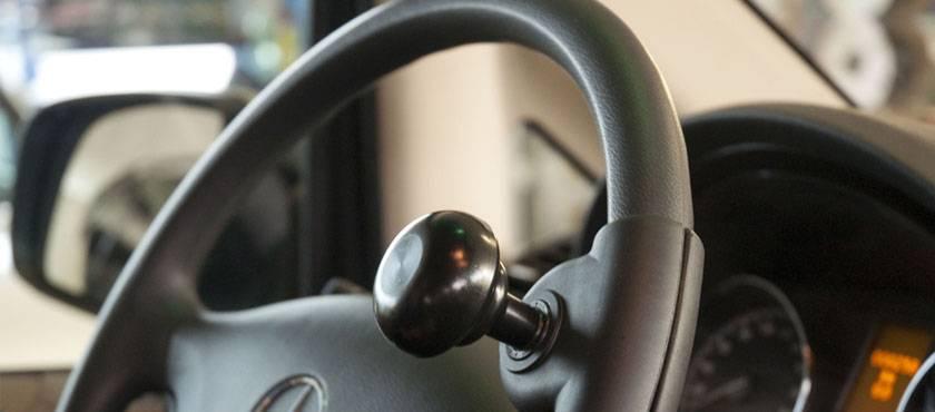 poign es ou boules au volant handi mobil. Black Bedroom Furniture Sets. Home Design Ideas